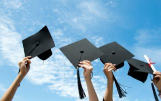 Holding Graduation Caps - Celebration Foundation 2019 Scholarships