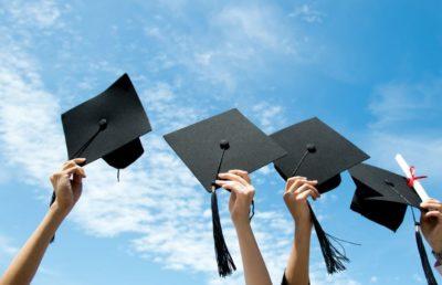 Holding Graduation Caps - Celebration Foundation 2019 Scholarships
