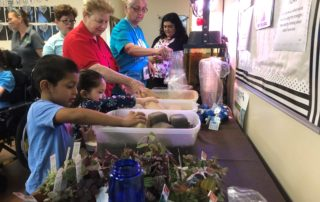 Children Building Terrariums - Celebration Foundation