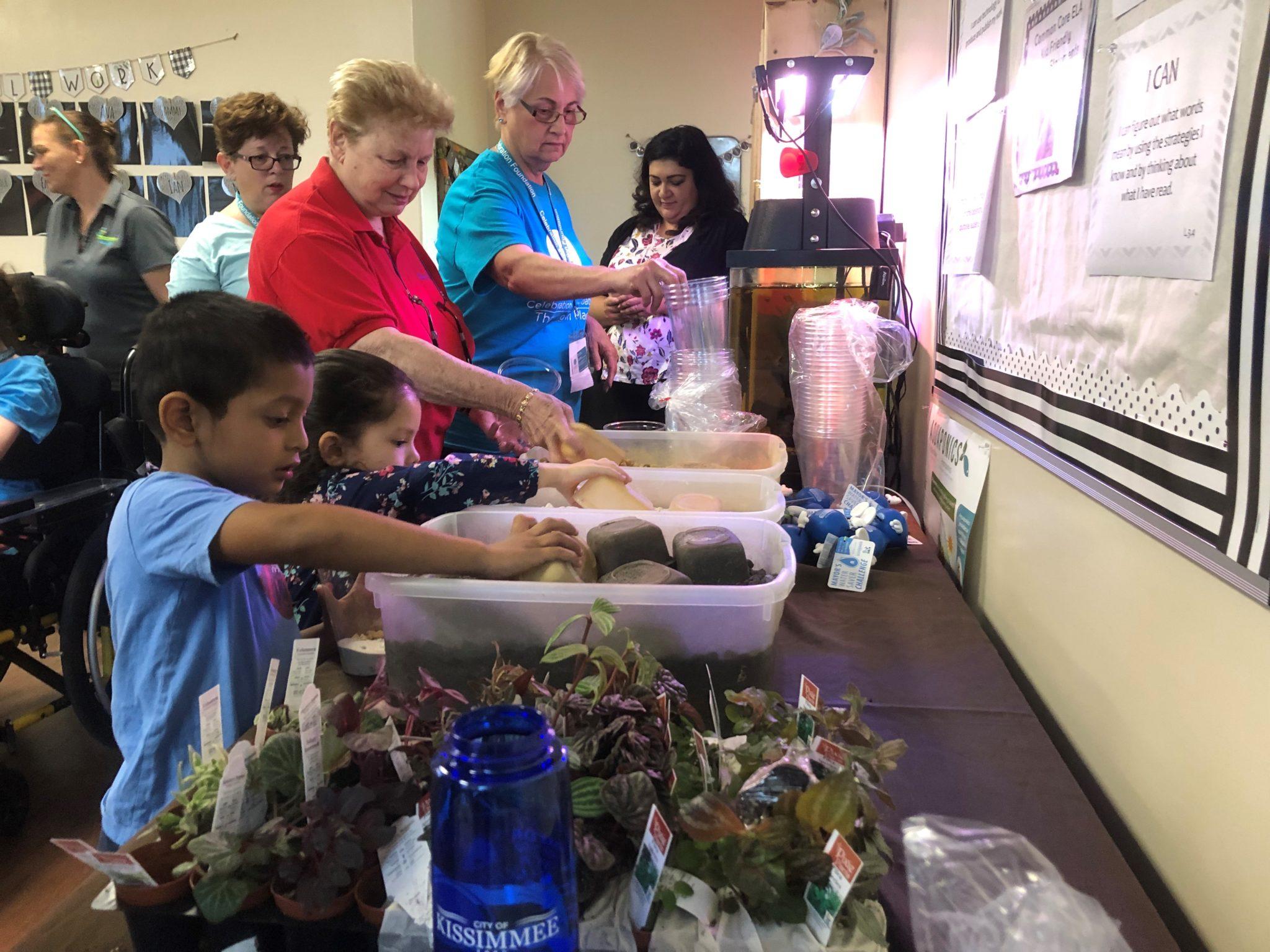 Children Building Terrariums - Celebration Foundation