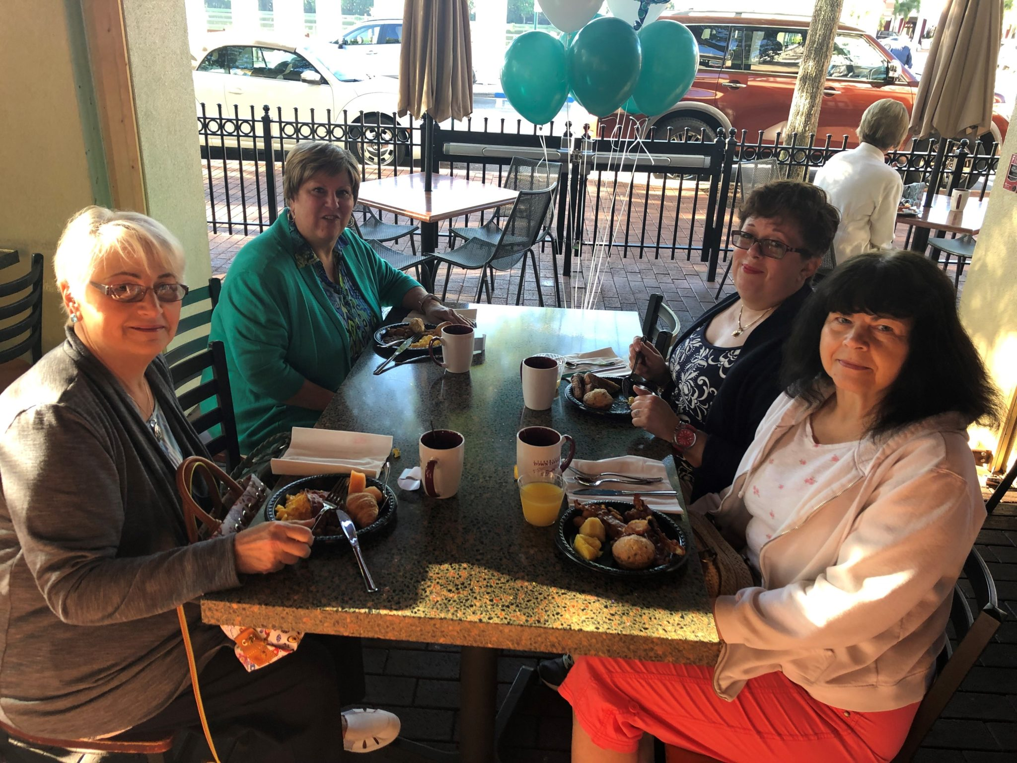 Volunteers Sitting at Breakfast During Volunteer Appreciation Party - Celebration Foundation