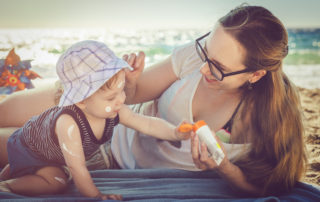 Mom placing sunscreen on child - Sunscreen Best Practices for Healthy, Radiant Skin - Celebration Foundation